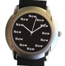 """Now"" Is the Time That Is Shown Each Hour on the Black Dial of the 2-tone Polished and Brushed Chrome Round with a Black Leather Strap"