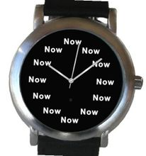 """Now"" Is the Time That Is Shown Each Hour on the Black Dial of the Brushed Chrome Round Shape with a Black Leather Strap"
