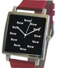 """Now"" Is the Time That Is Shown Each Hour on the Black Dial of the Polished Chrome Square Shape with a Red Leather Strap"