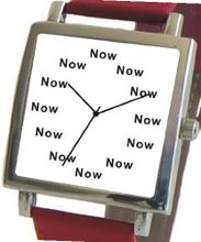 """Now"" Is the Time That Is Shown Each Hour on the White Dial of the Polished Chrome Square Shape with a Red Leather Strap"
