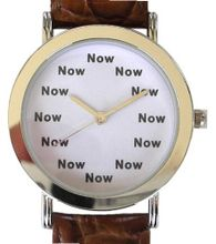 """Now"" Is the Time That Is Shown Each Hour on the White Dial of the Polished Chrome Tone Round with a Brown Croc Design Leather Strap"